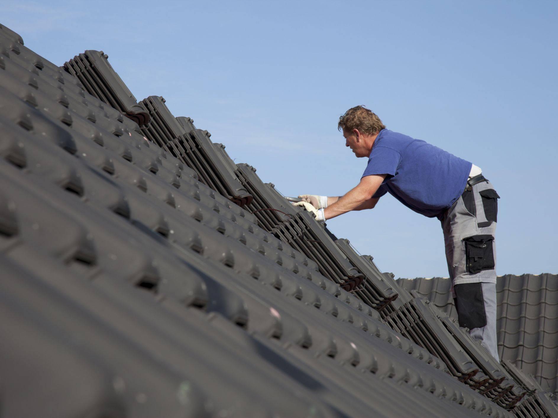 Roofers Shingling a House 56a49bd23df78cf d2