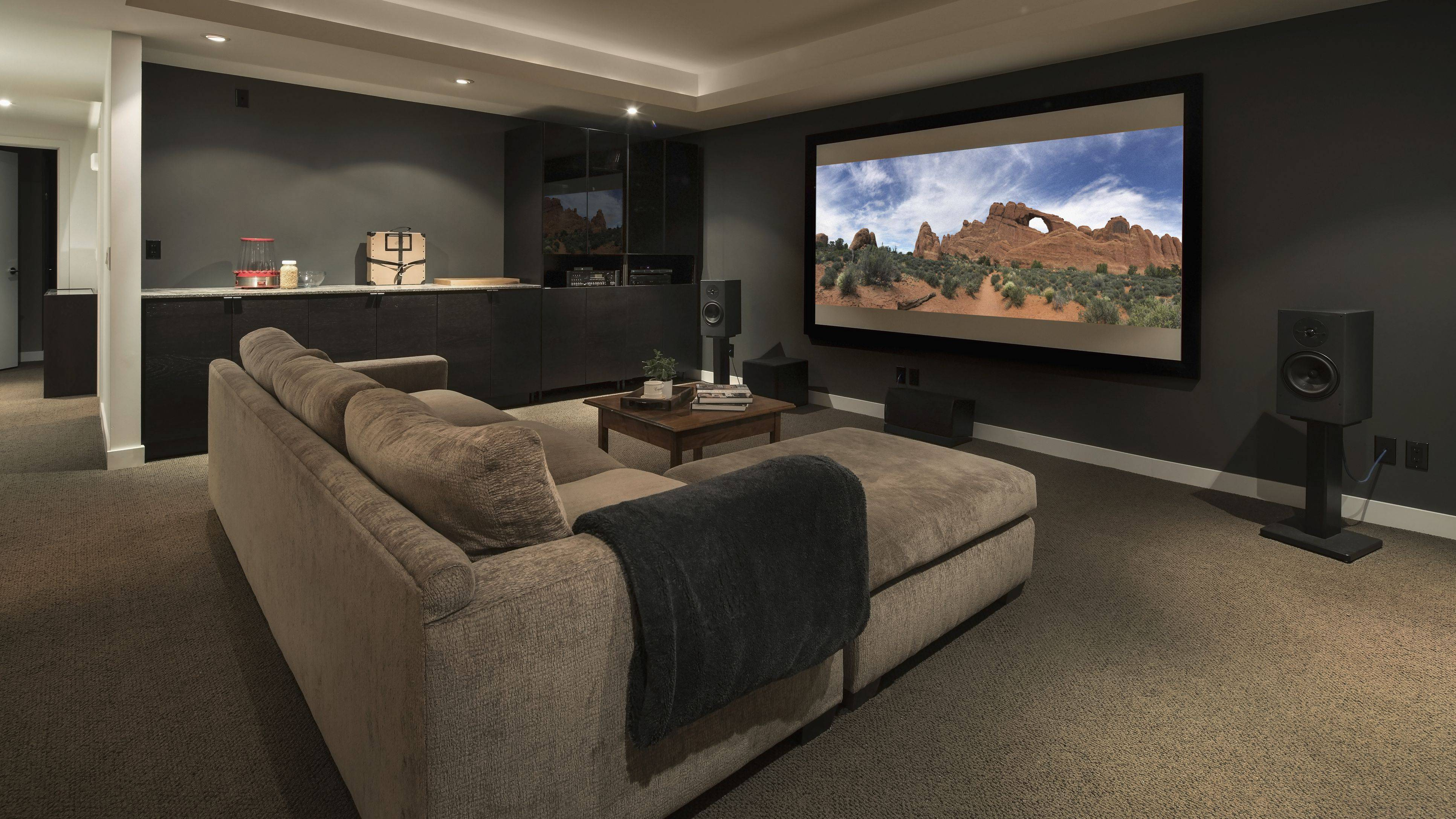 movie playing on projection screen in home theater 5bdb7eb0c9e77c0026d2970f