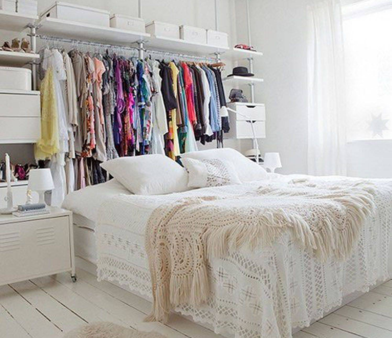 Clothes storage behind the bed 56a f9b58b7d0e60ee6