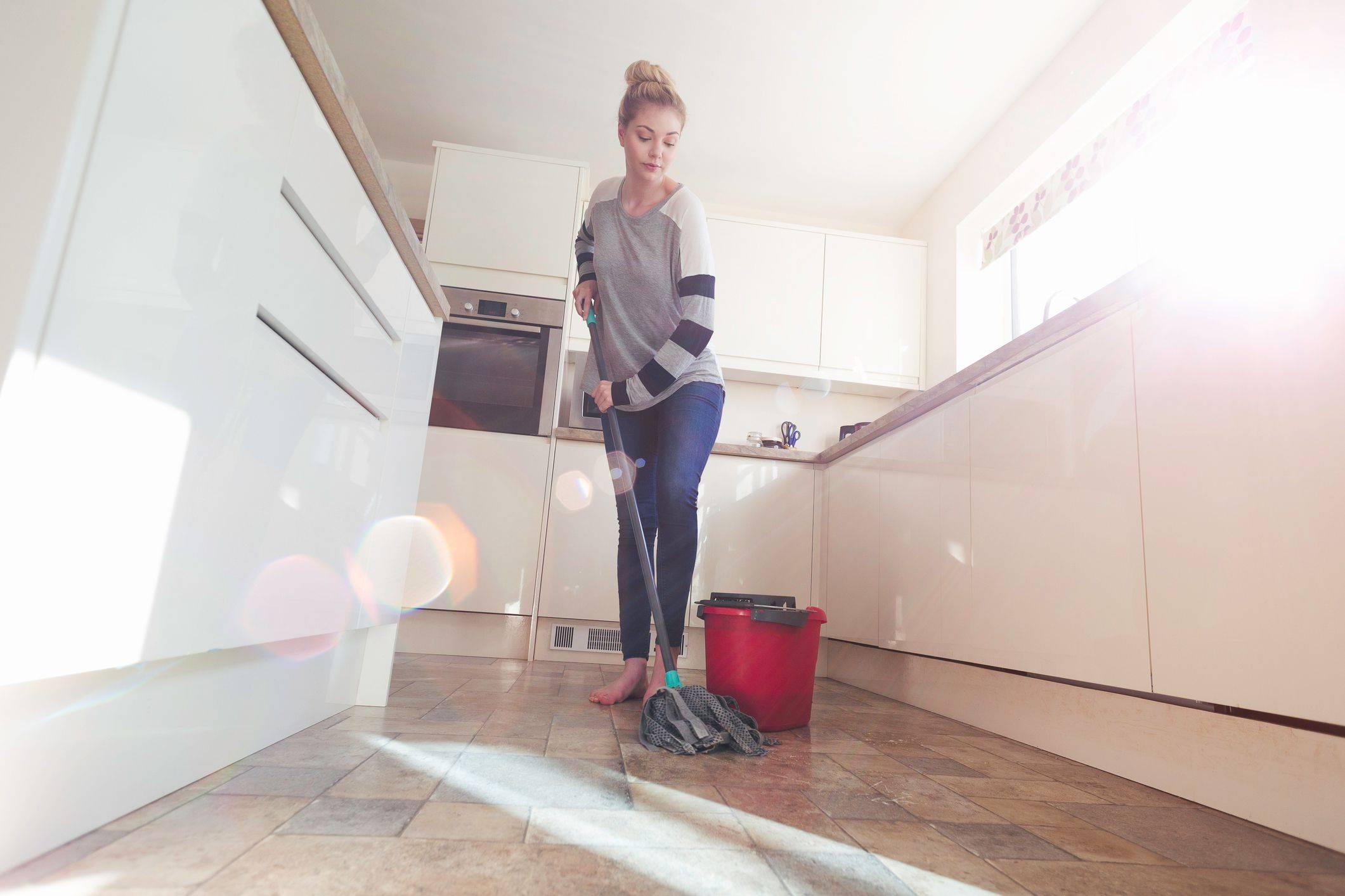 Woman Mopping floor Getty d343df78caebcbeee89