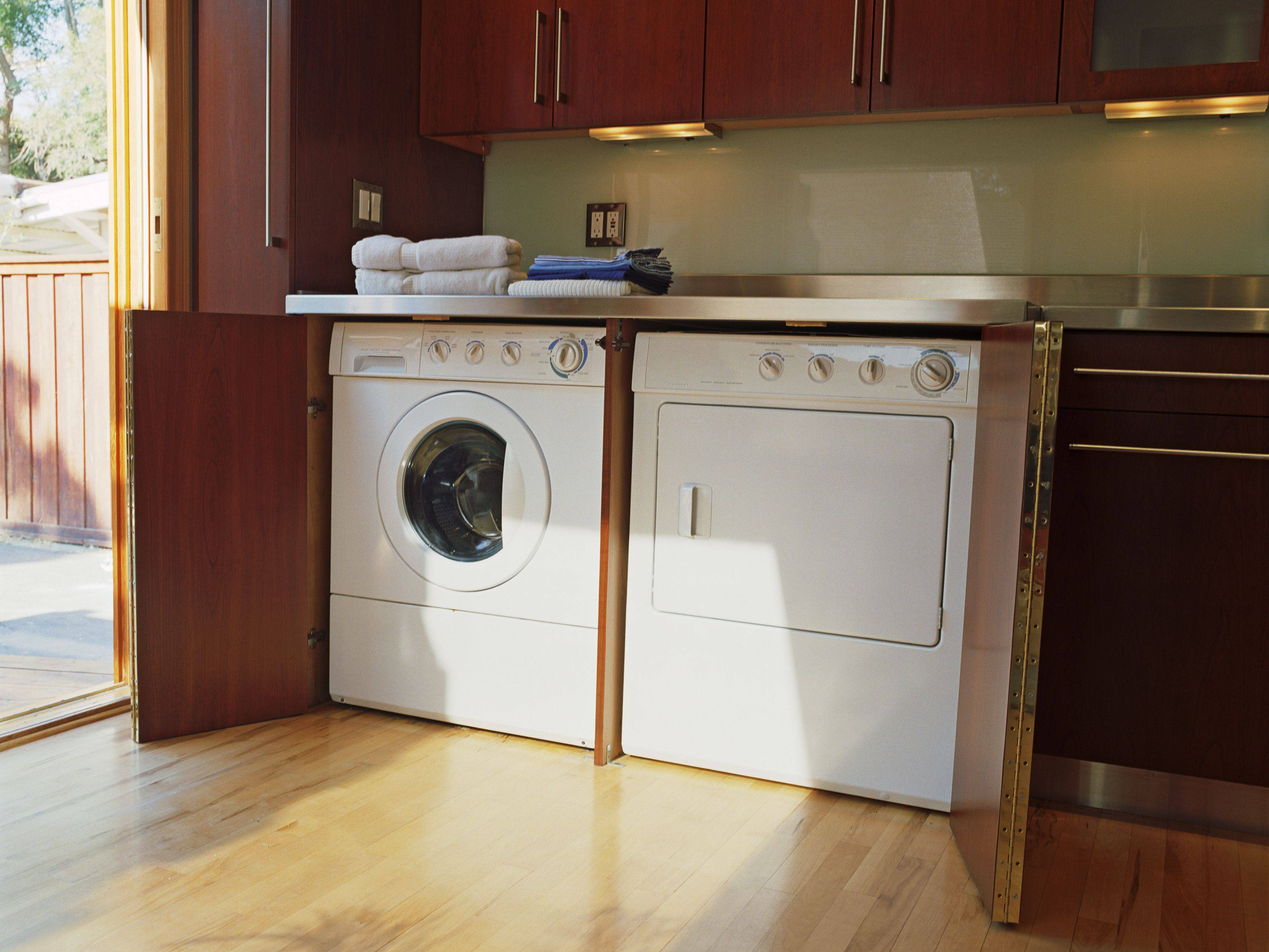 washer and dryer in corner of kitchen 5ac85f32eb97de afea7