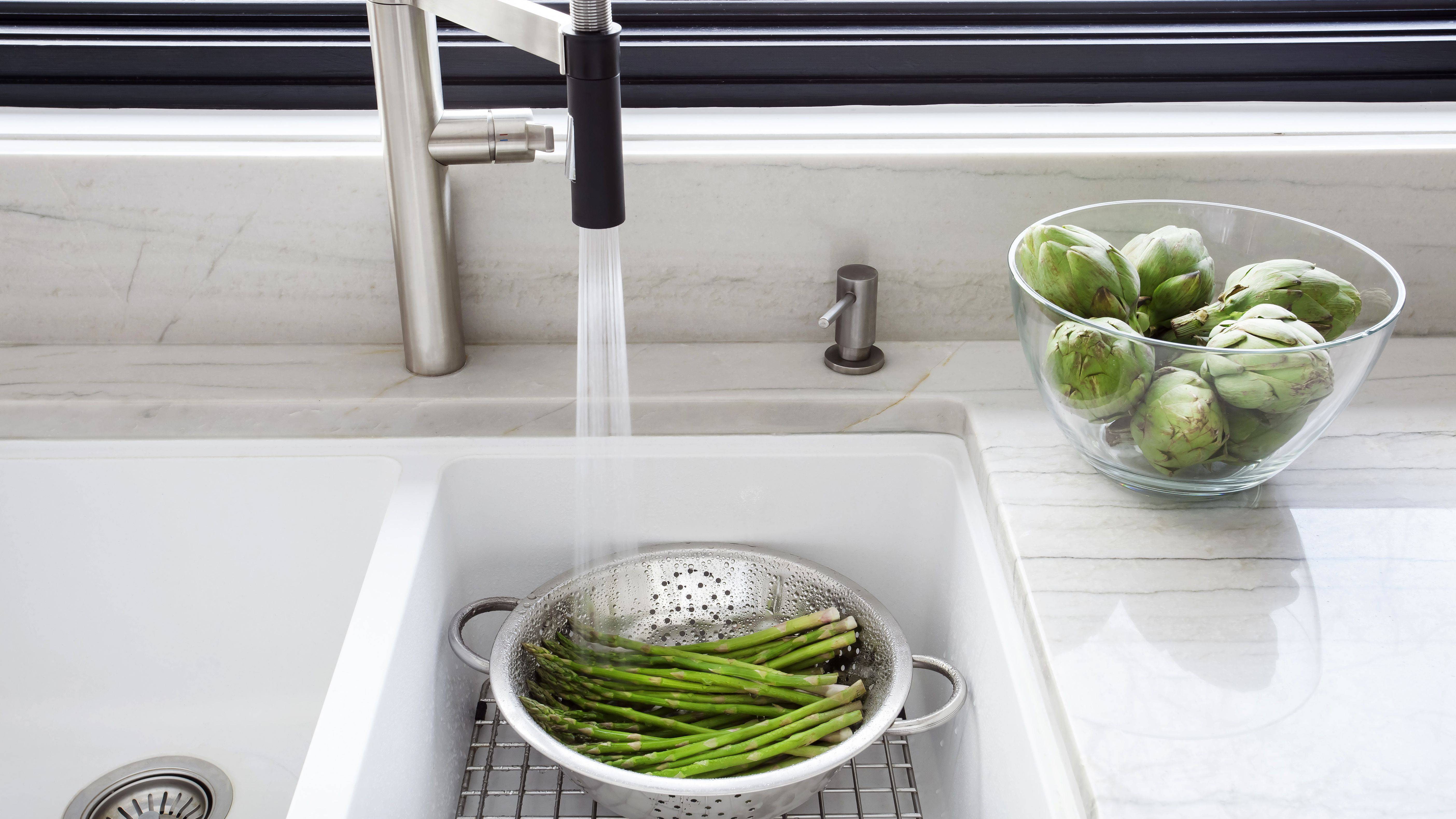 washing fresh asparagus in the kitchen sink 5a ae9ab ee74