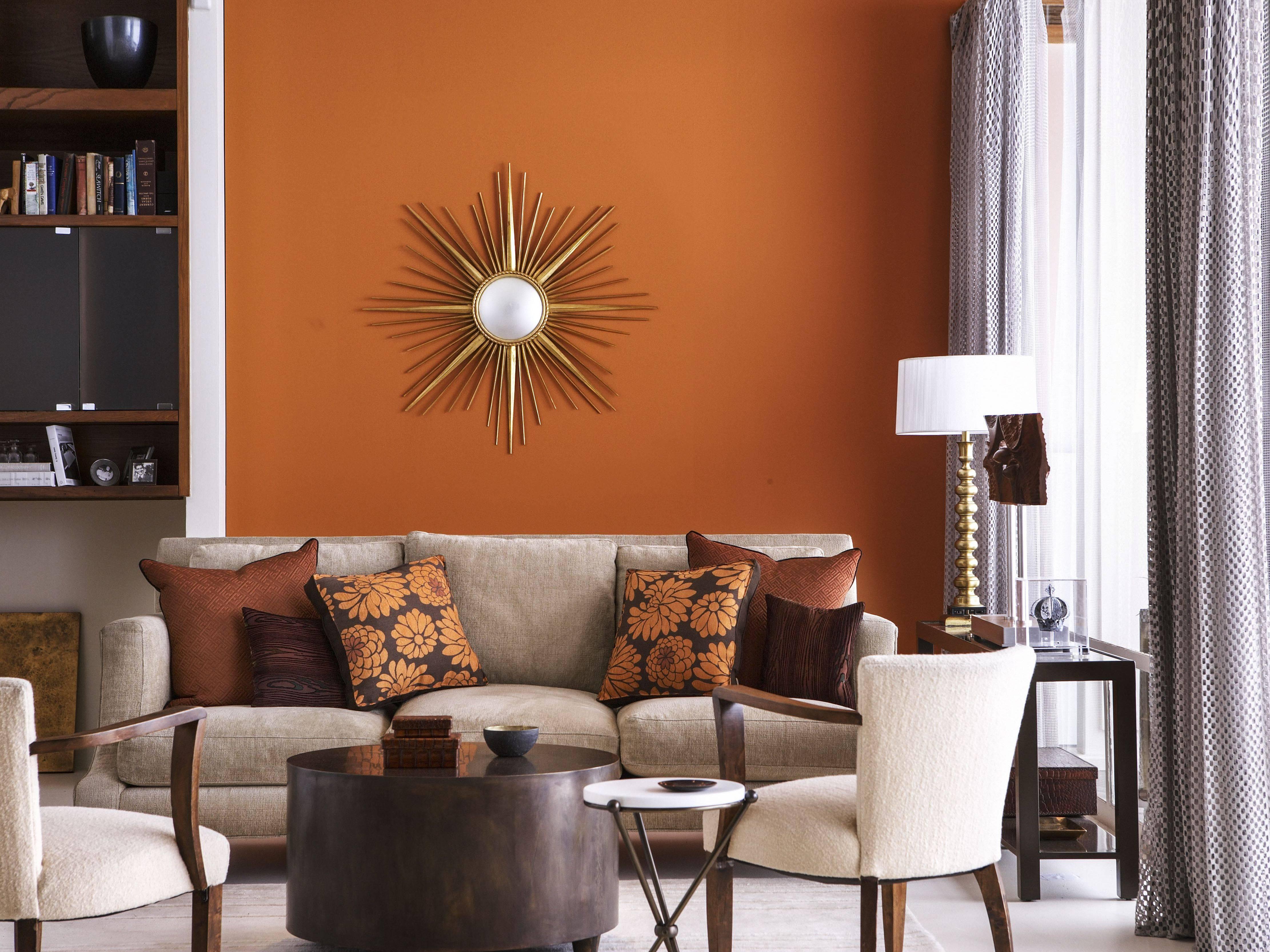living room with orange wall 5ab a18d9e0037c3a9ba