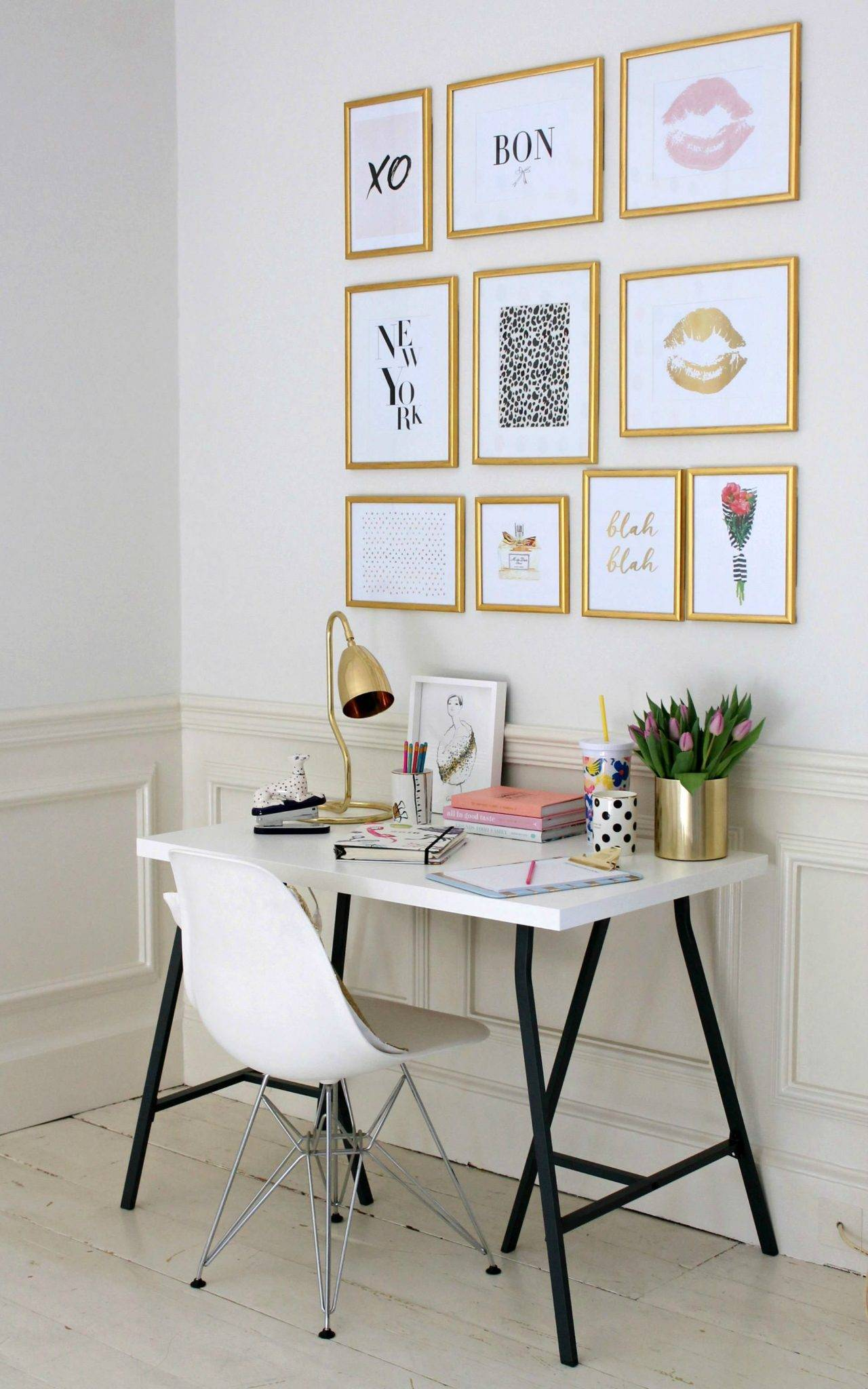 Golden wall gallery in a white office