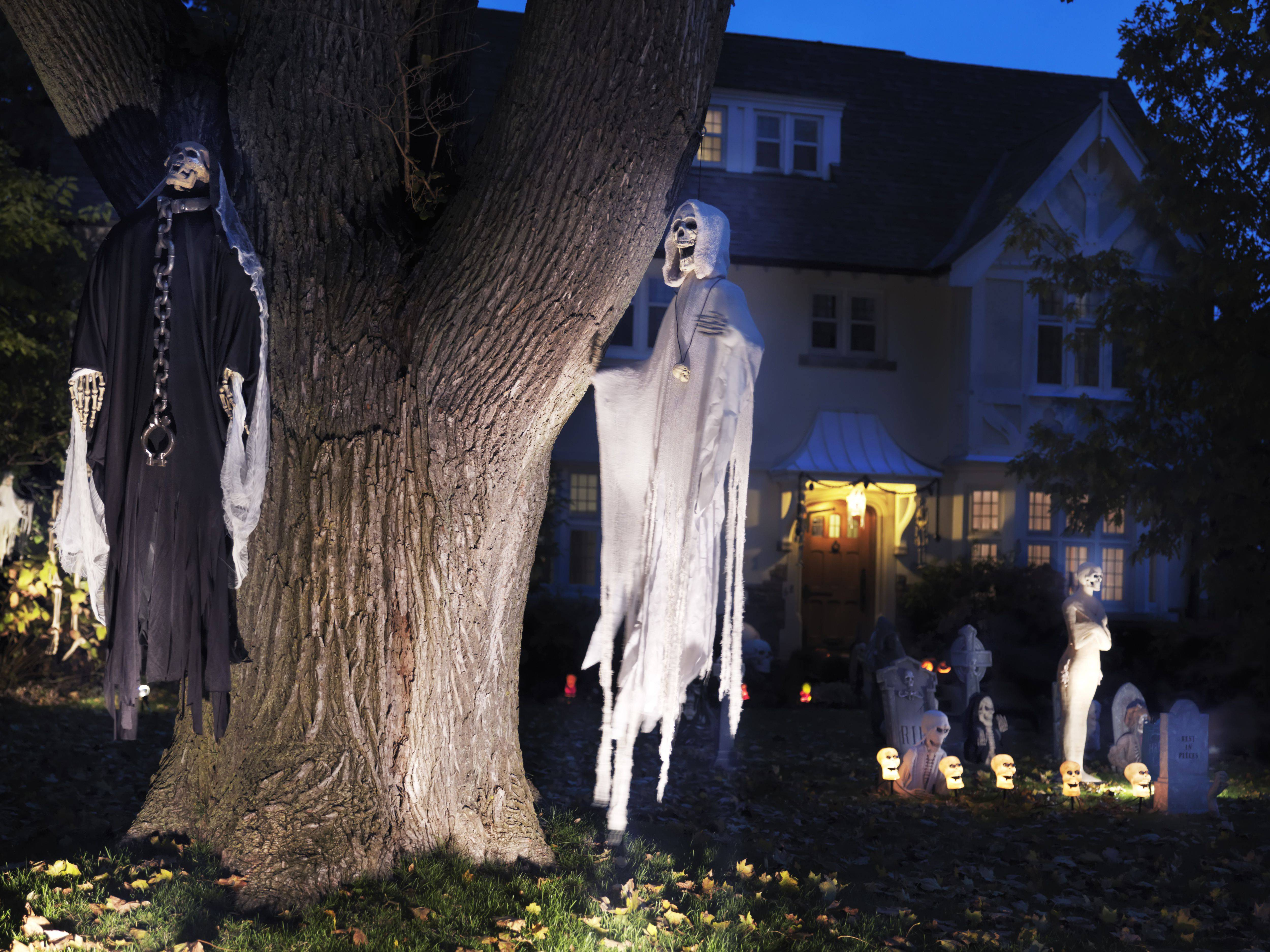 spooky halloween decoration ghosts and cemetery in the front yard of a house in canada 59a8a67ad088c d