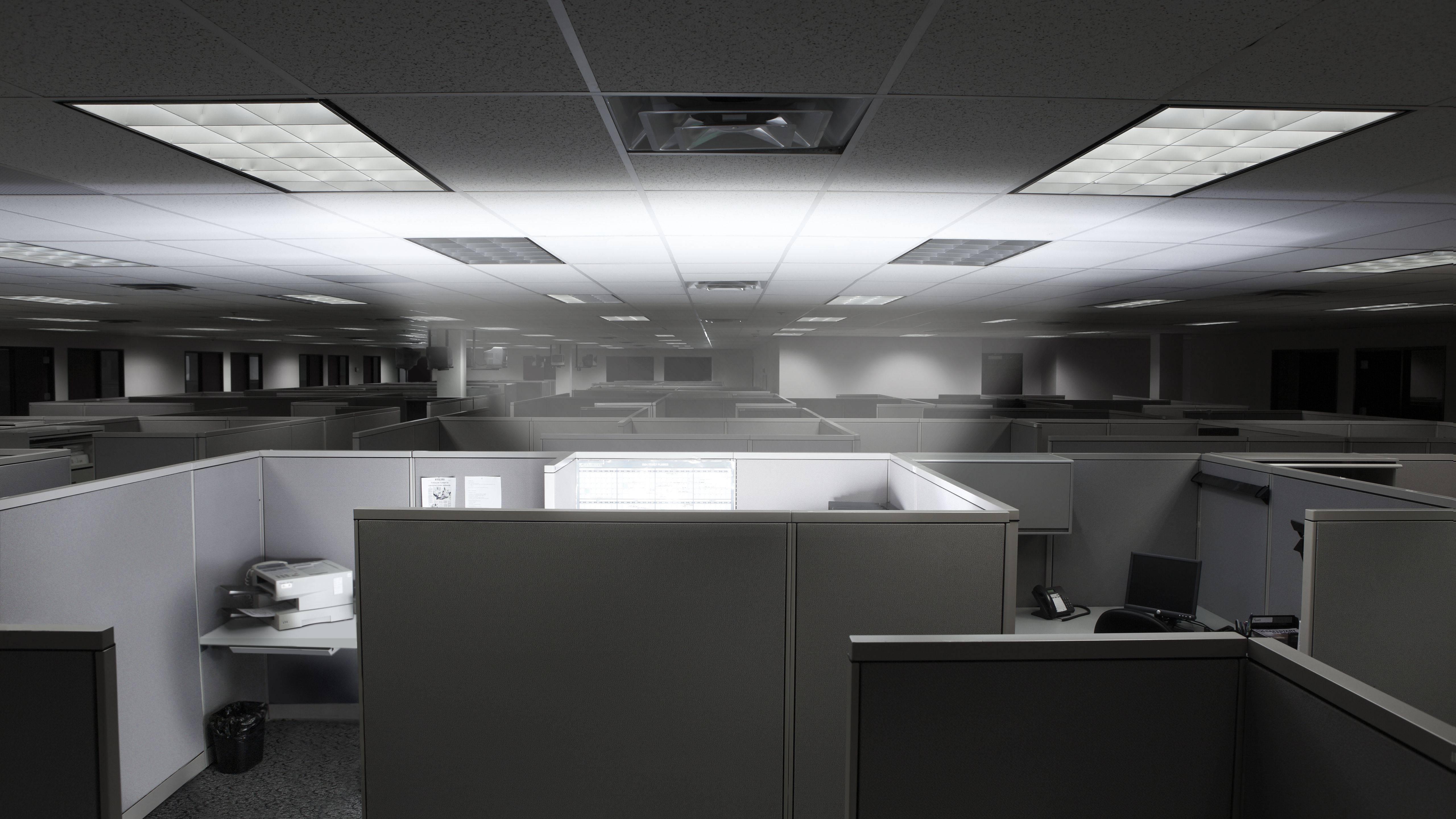 glowing cubicle in an empty office 5b266a25eb97de