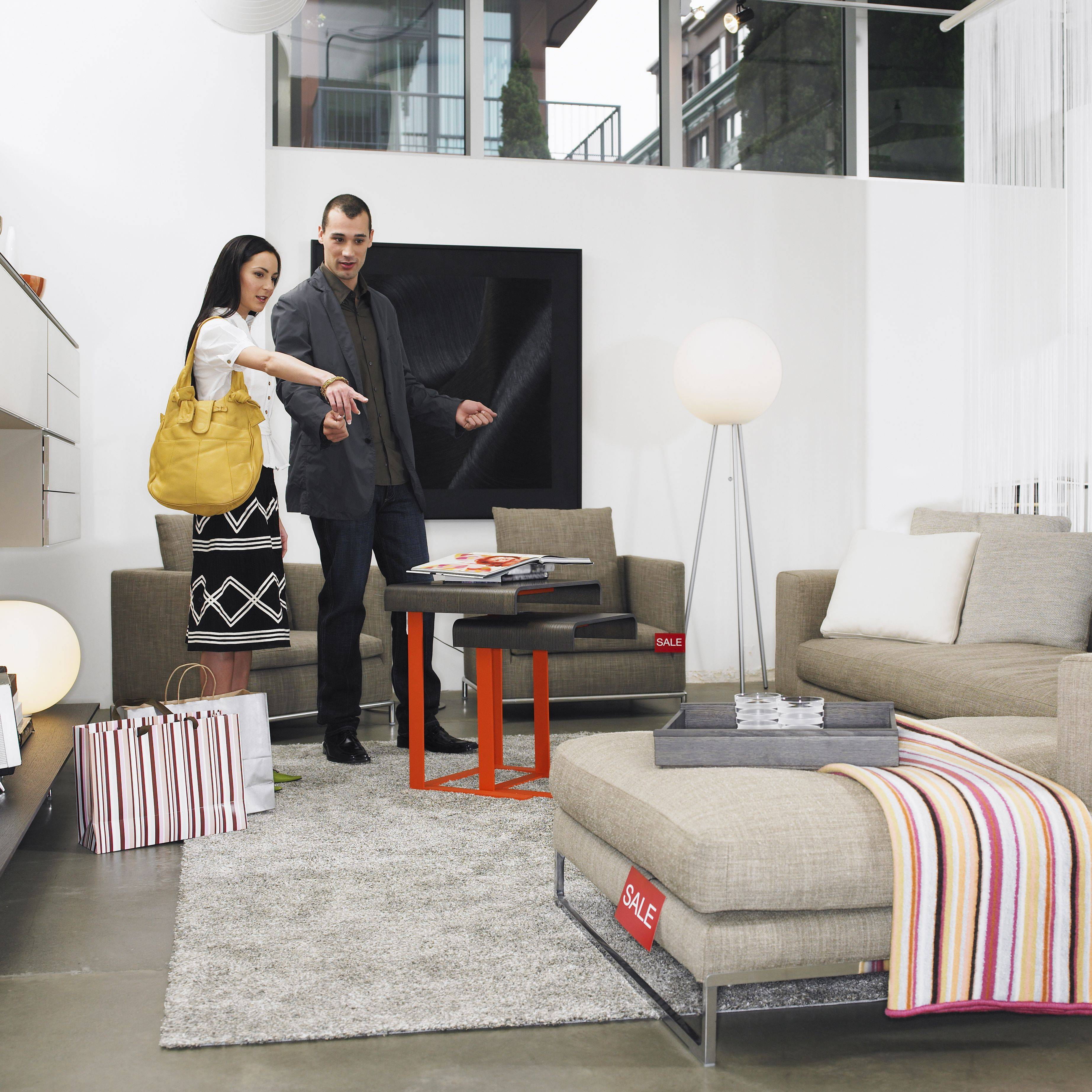 young couple looking at sofa in furniture store 001 57c49dc15f9b5855e5e84c05