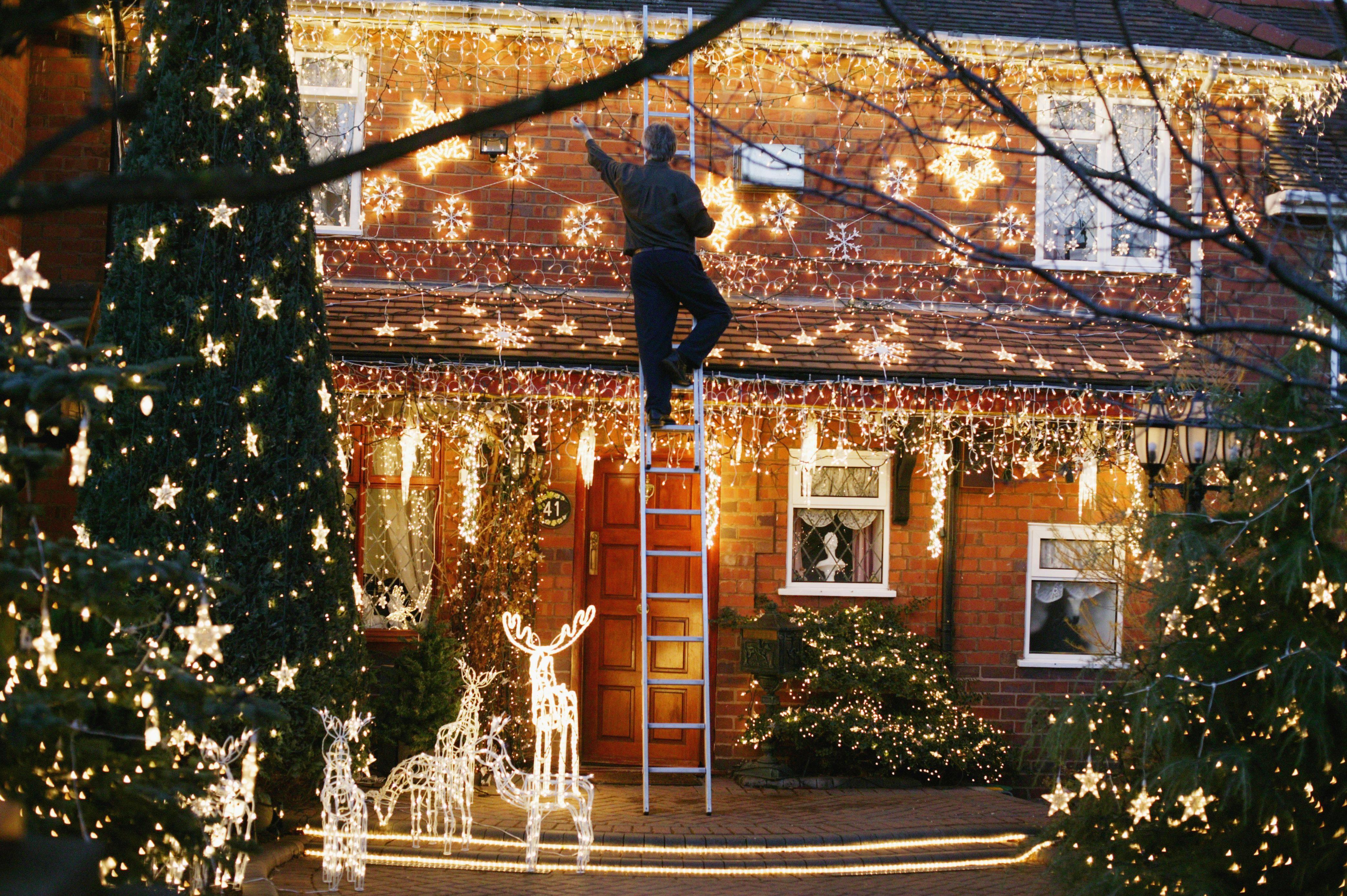 christmas lights in the front garden of a house 5a1ef4ff4e46ba001a9ac0bf