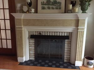 Rustic Fireplaces Unique Stencil Over Black Tile Just to Jazz Up the Fireplace