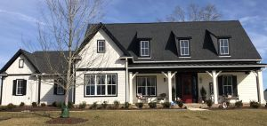 Stucco House with Metal Roof Elegant Alabaster Siding Tricorn Black Trim Wild Currant Front