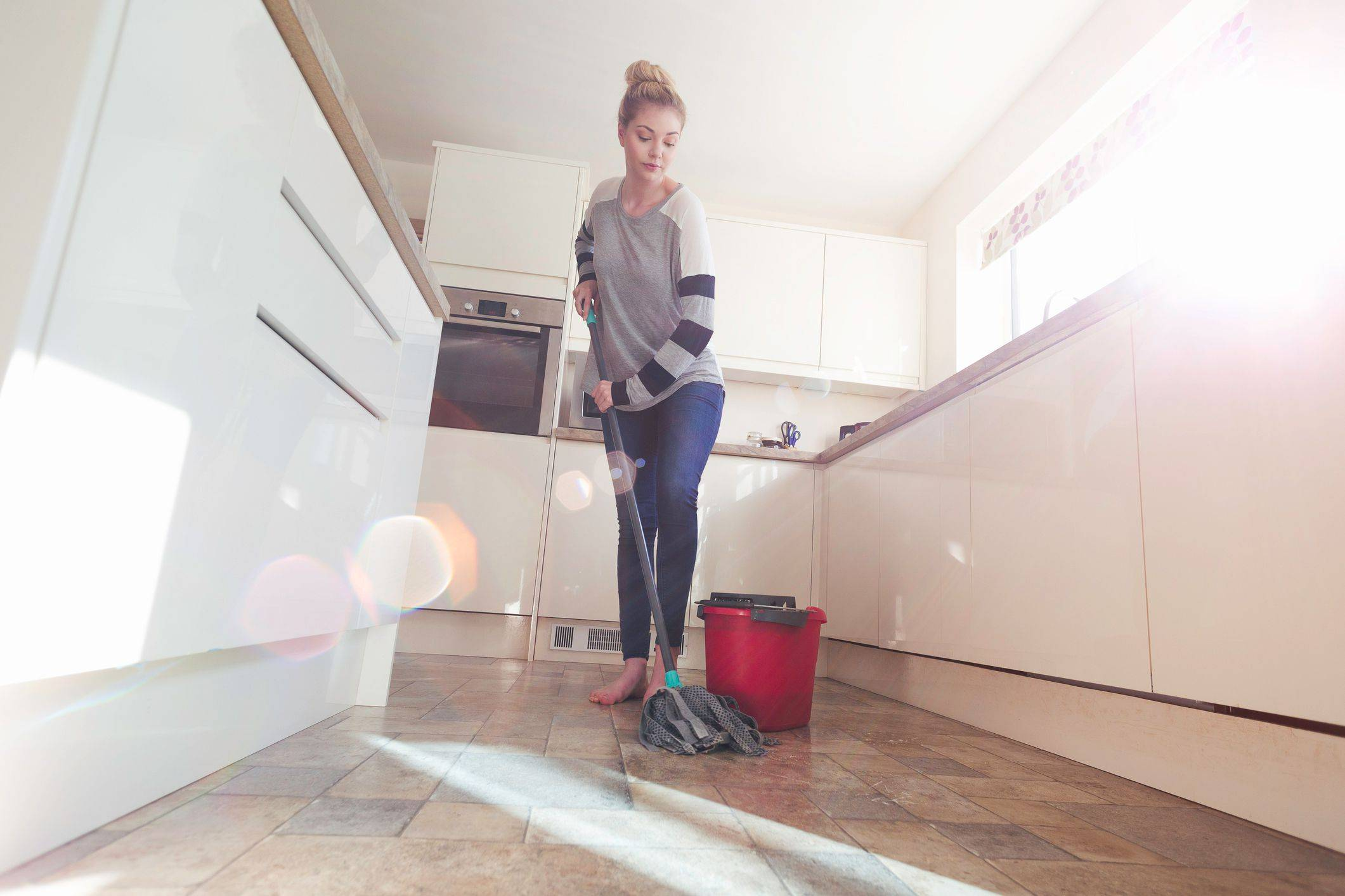Woman Mopping floor Getty d343df78caebcbeee89