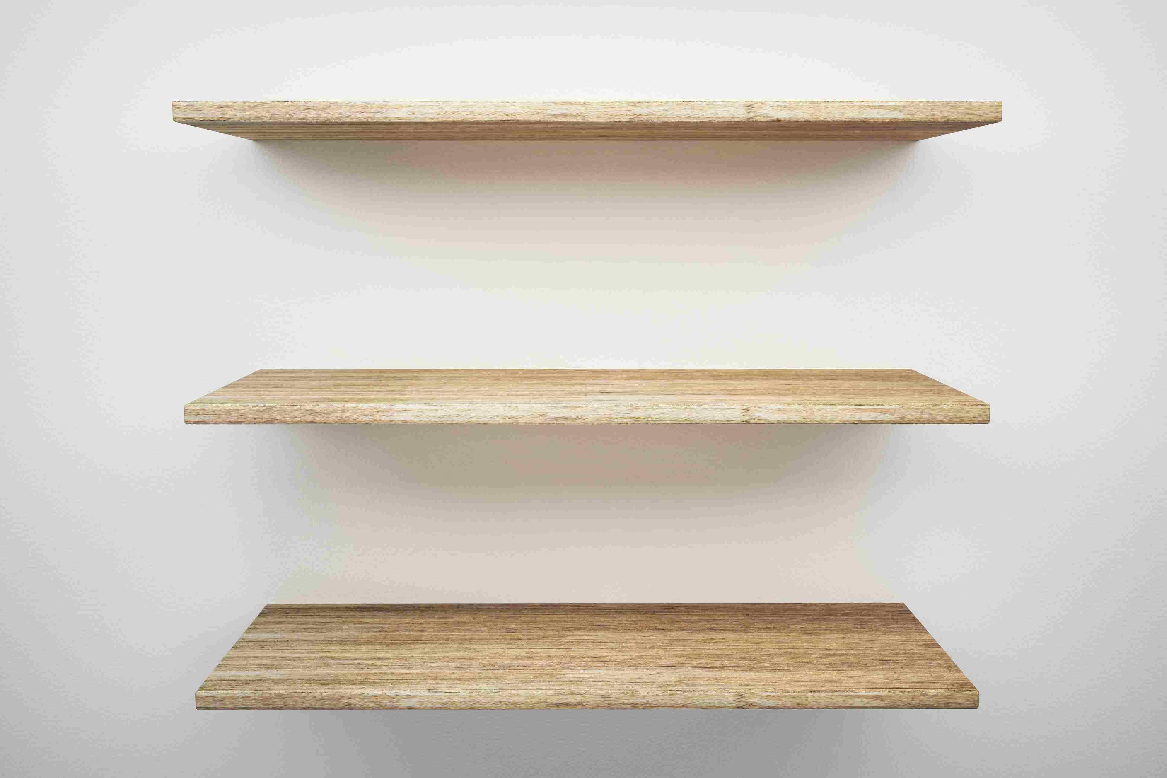 wooden shelves mounted on white wall 5b7cf7ebc9e77c
