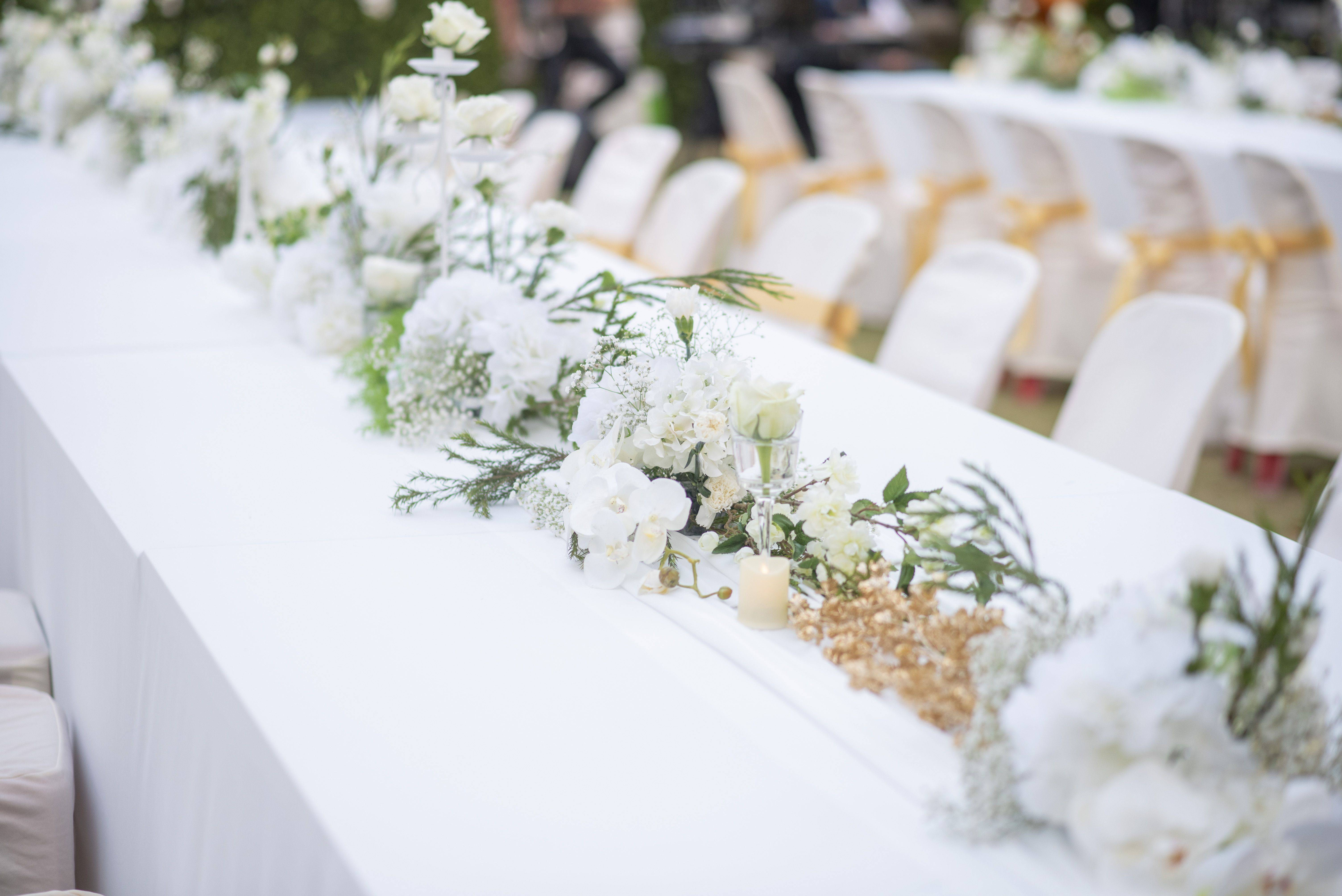 close up of flowers on table at wedding ceremony royalty free image