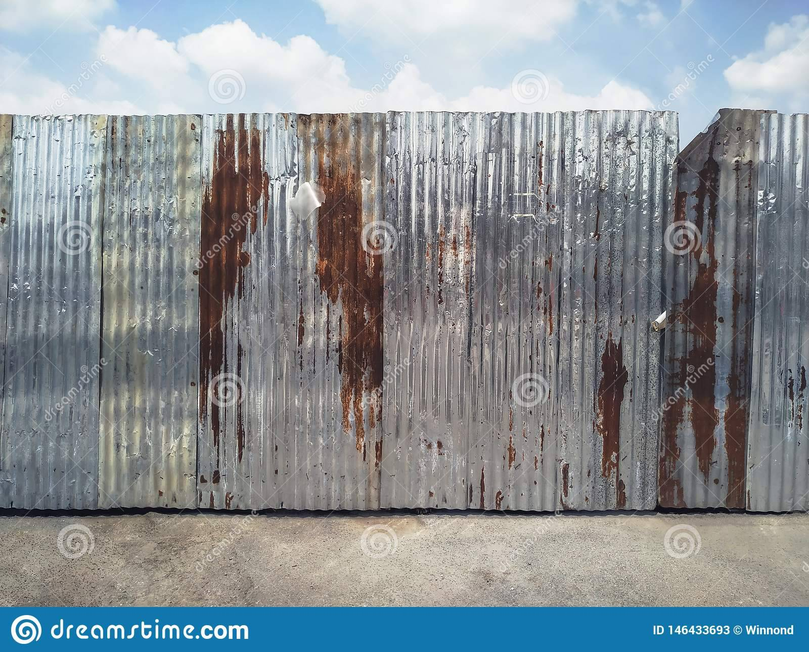 rusty corrugated metal fence old construction site