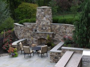 Indoor Outdoor Fireplace Best Of Outdoor Fireplace Incorporated Into High Stone Wall with