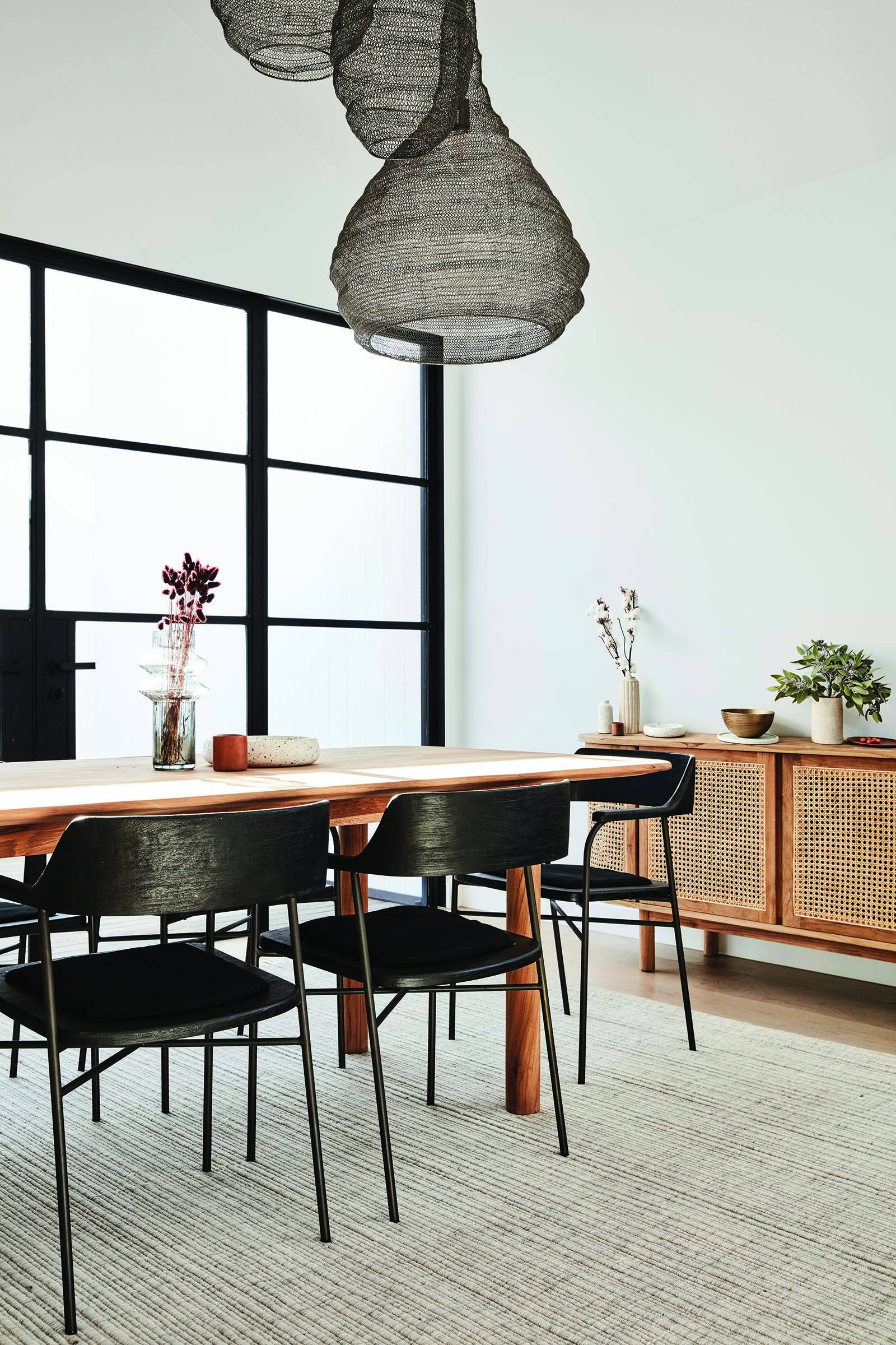 globwest 2020 interior design trends timber dining table with black timber dining chairs and sideboard with mesh front