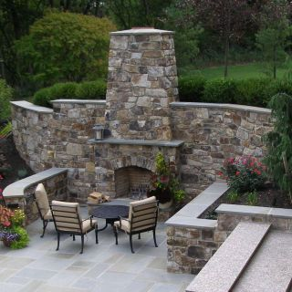 Outdoor Fireplace Grill Elegant Outdoor Fireplace Incorporated Into High Stone Wall with
